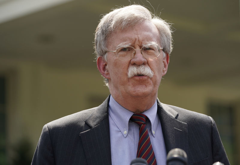 © Reuters. FILE PHOTO:  White House national security adviser Bolton talks about Venezuela outside White House in Washington