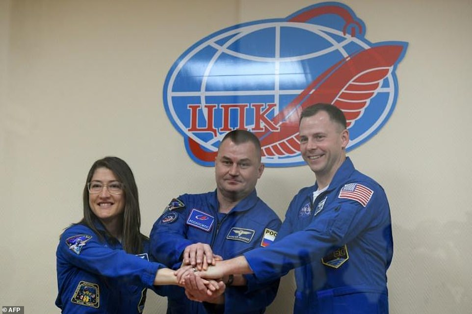 Astronaut Christina Hammock Koch (left) took the photo of the Earth's 'shadow line' aboard the ISS. Pictured, she and colleague Nick Hague (right) together with Russian Alexey Ovchinin successfully blasted off on a mission to the ISS