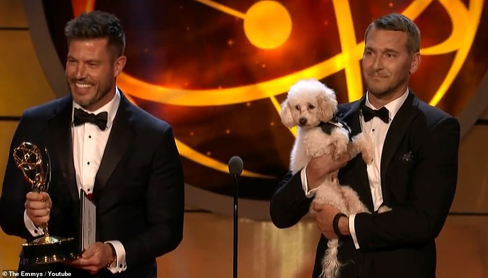 Aww! The host first appeared on stage alongside Lucky Dog host Brandon McMillan, who carried a fluffy white dog onto the stage