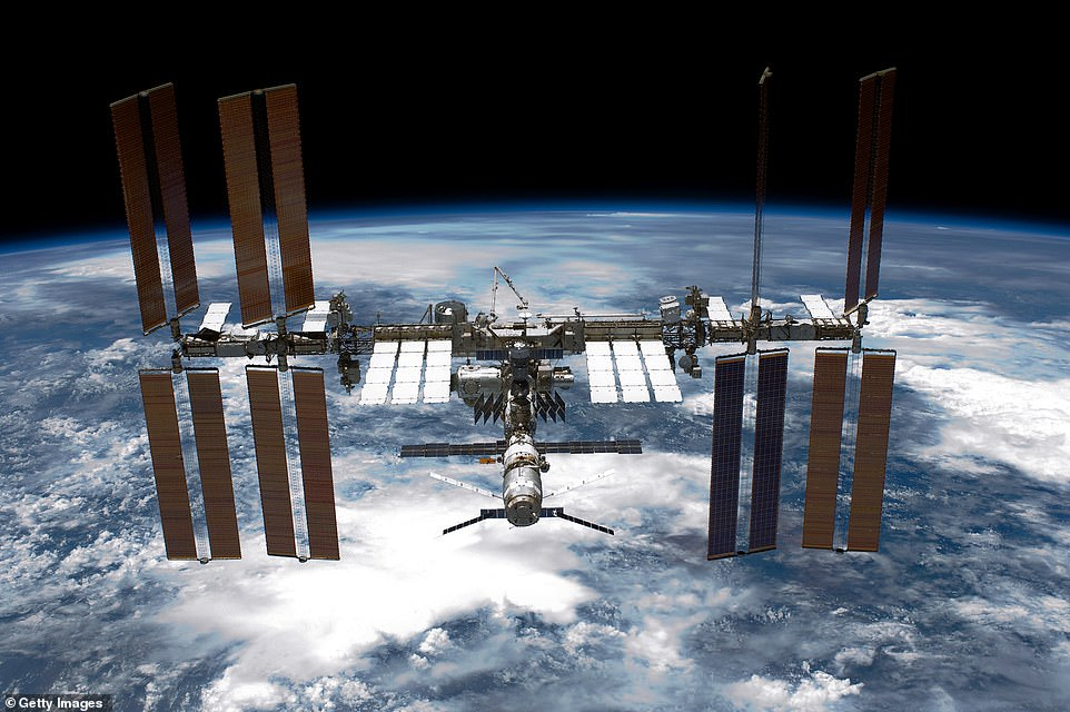 Astronauts aboard the ISS (pictured) are used to spotting mesmerizing views of the Earth's sunrises and sunsets.The ISS orbits roughly 220 miles above the Earth and completes one trip around our planet every 92 minutes, according to NASA