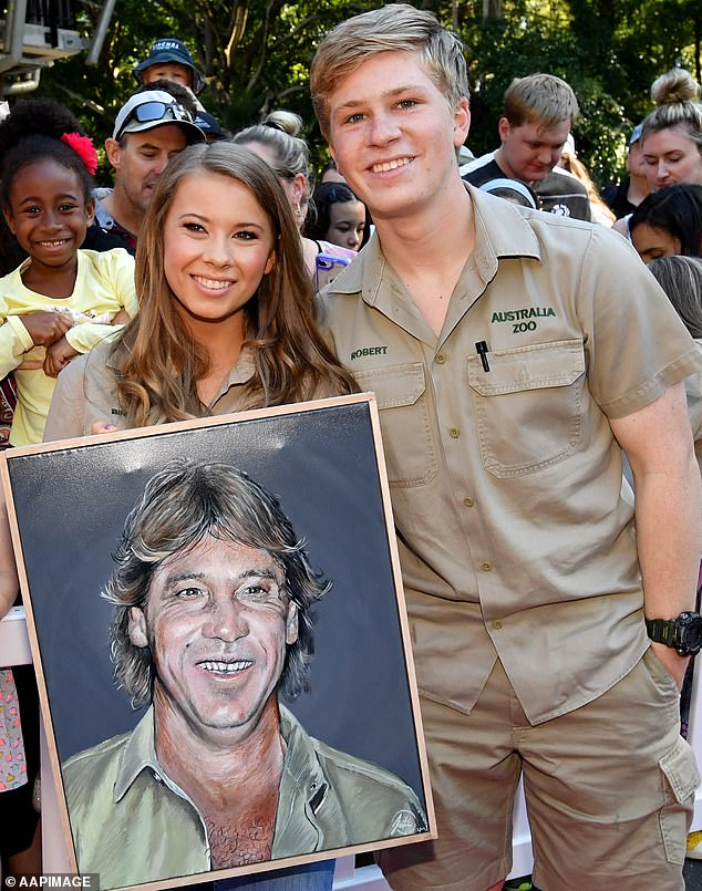 Getting hitched!Bindi Irwin (L) has been a future bride since Wednesday, and she already has a first request - to have her younger brother, Robert, walk her down the aisle