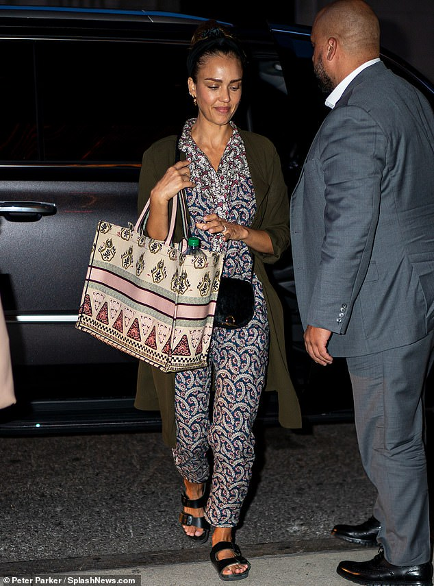 Pretty in patterns: Jessica Albalooked fashionable as always as she arrived at a New York City hotel on Sunday night