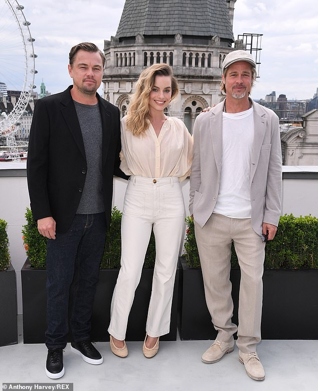All stars: Margot Robbie wore a light coloured ensemble as she joined Leonardo DiCaprio (left) and Brad Pitt (right) at the Once Upon A Time In Hollywood UK photocall