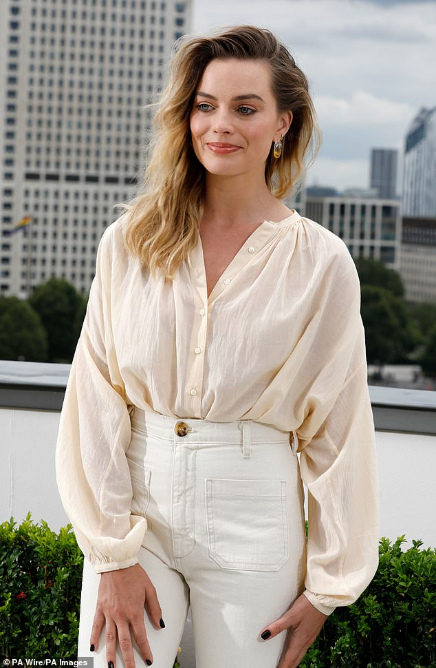 Stunning: Margot showed off her natural beauty at the event