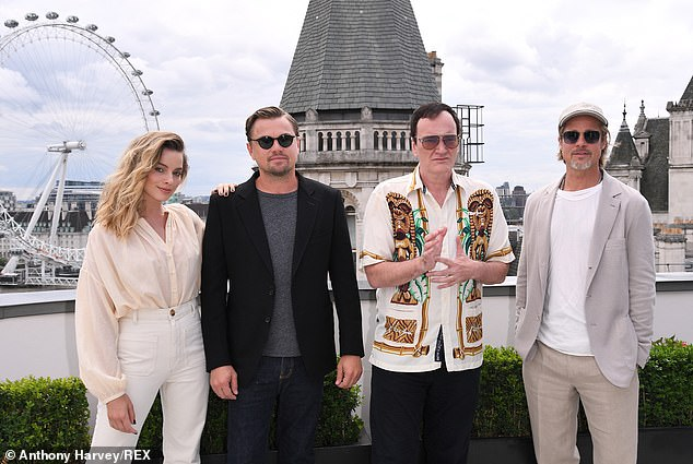 Iconic: Director Quentin Tarantino (second from right) was also present at the photocall and posed with the rest of the cast for a couple of snaps