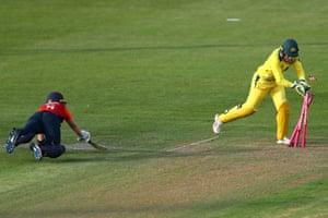 Heather Knight of England is run out as Australia wicketkeeper Alyssa Healy breaks the stumps.