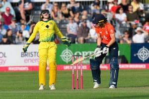 Alyssa Healy of Australia celebrates catching Amy Jones of England.