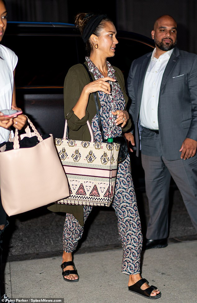 Showing her style:Jessica accessorized with a small black leather Chloe bag as she lugged along a large patterned tote bag