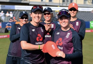 Heather Knight presents a cap to Mady Villiers.