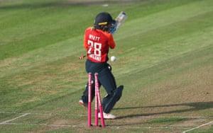 England's Danielle Wyatt is bowled by Australia's Megan Schutt for 20.