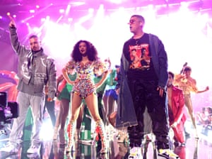 Balvin, Cardi B, and Bad Bunny perform onstage at American Music Awards, 2018.