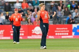 Katherine Brunt of England celebrates taking the wicket of Beth Mooney of Australia.
