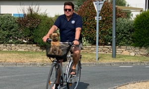 Nicolas Tanguy on his bike in Brittany, with dog in basket