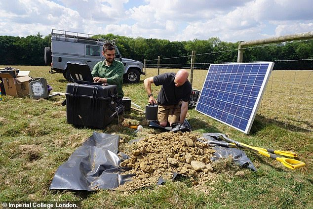 Earthquakes that rocked Surrey and Sussex sparking mass protests were not caused by fracking, a new report suggests. Pictured: Dr Stephen Hicks and Dr David Hawthorn installing a seismometer close to one of the affected areas