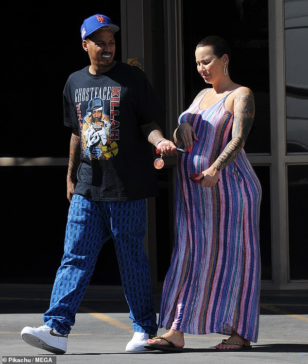 Day date:Amber Rose stepped out for some lunch with her boyfriend and father to her child Alexander 'AE' Edwards