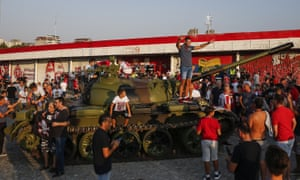 Fans pose with a former Yugoslav army T-55 tank before the game between Red Star Belgrade and Young Boys.