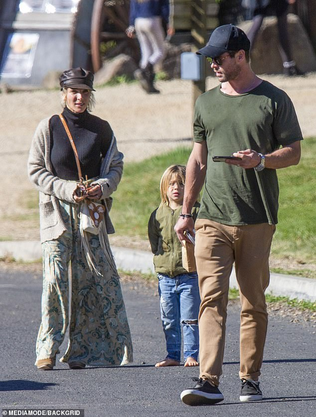 My brother's keeper? Chris Hemsworth appeared tense during a family outing for his 36th birthday in Byron Bay on Sunday, after younger sibling Liam Hemsworth ended his marriage to Miley Cyrus. Pictured with wife Elsa Pataky and their son