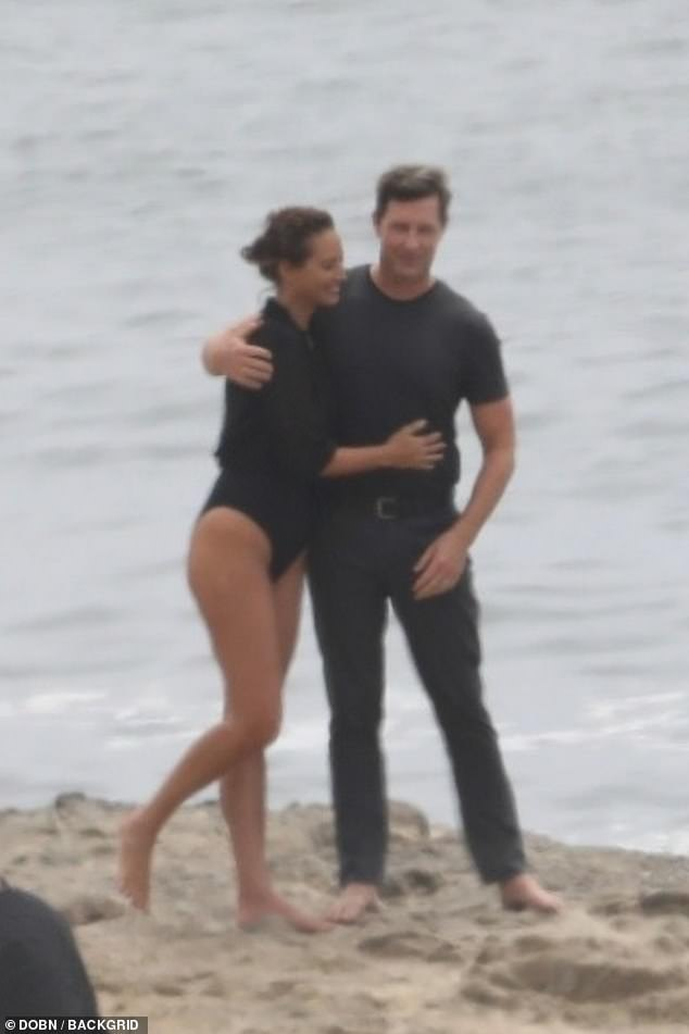 Sweet: Christy Turlingtonlooked absolutely fantastic during a rare beach photoshoot in Malibu, California with husband Edward Burns