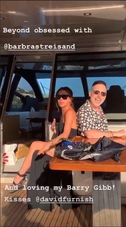 Victoria Beckham and David Furnish singing together on Sir Elton John's yacht