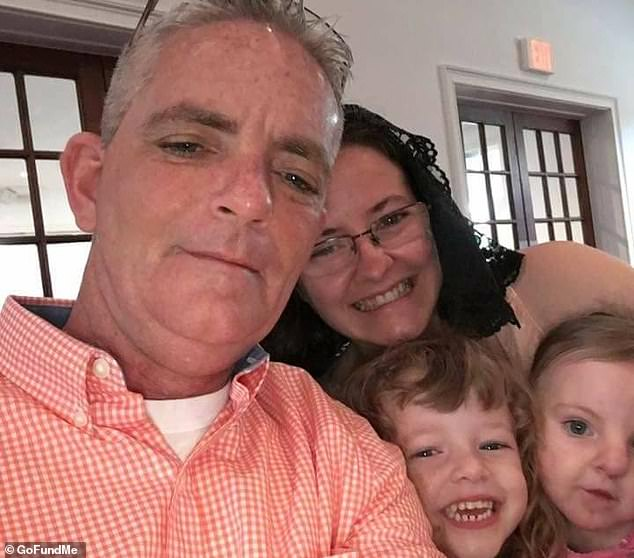David Ireland (left) has had to have 25% of his skin stripped off after contracting a flesh-eating bacterial infection. Pictured with his wife, Jody and daughters Rebekah and Ruth