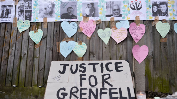 Home made posters appealing for information on people missing since the Grenfell apartment tower block caught fire are seen next to messages of sympathy in North Kensington, London, Britain, June 17, 2017. REUTERS/Hannah McKay
