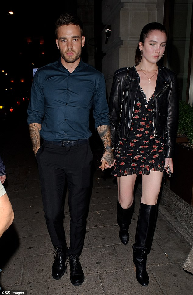 Night out:Liam Payne has been spotted holding hands with a mystery woman on a night out in Mayfair on Friday