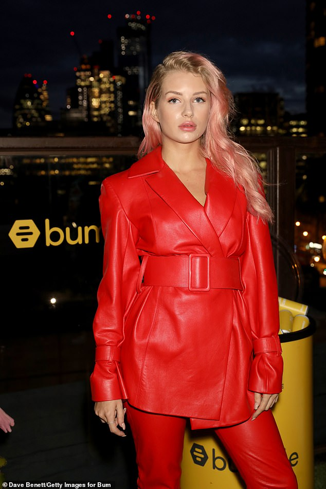 Pink lady:Lottie Moss debuted a new new pink hairstyle on Wednesday evening, as she stepped out to attend a singles party in East London