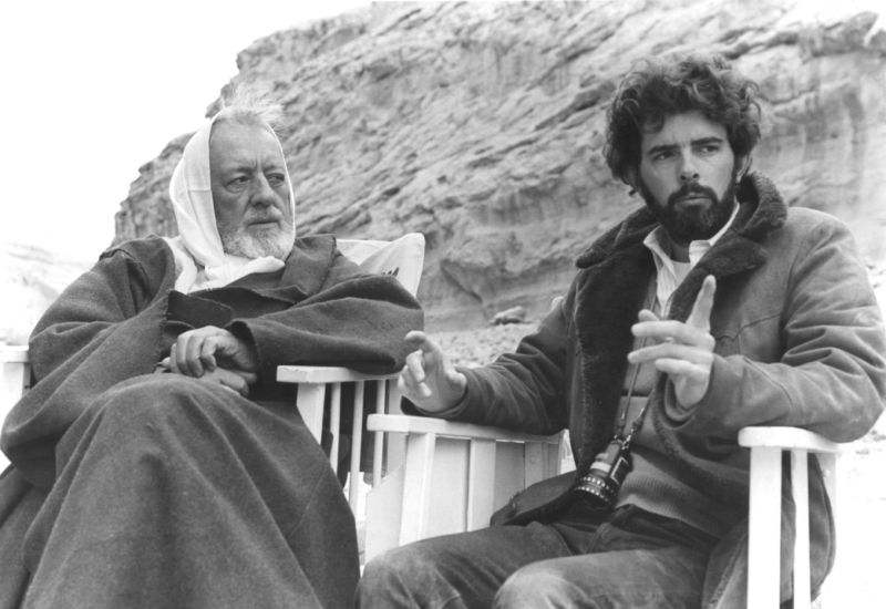 British actor Alec Guinness with American director, screenwriter and producer George Lucas on the set of his movie Star Wars: Episode IV - A New Hope. (Photo by Sunset Boulevard/Corbis via Getty Images)