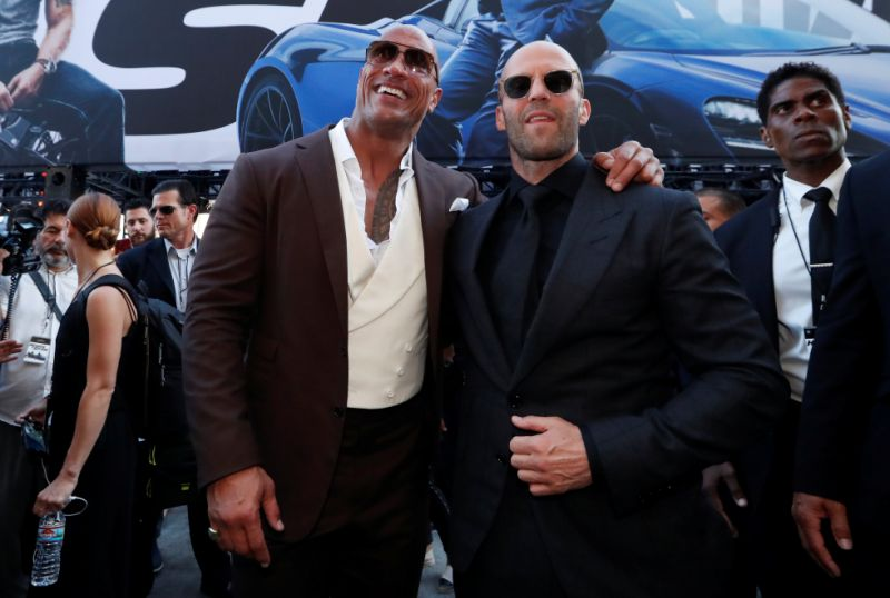"Cast members Dwayne Johnson and Jason Statham arrive at the premiere for ""Fast & Furious Presents: Hobbs & Shaw"" in Los Angeles, California, U.S., July 13, 2019. REUTERS/Mario Anzuoni"