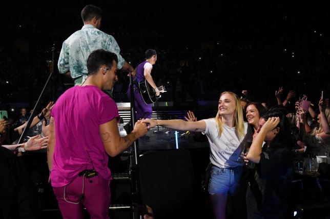 """NEW YORK, NEW YORK - AUGUST 29: Joe Jonas greets Sophie Turner in the audience during Jonas Brothers """"Happiness Begins"""" Tour at Madison Square Garden on August 29, 2019 in New York City. (Photo by Kevin Mazur/Getty Images for Philymack)"""