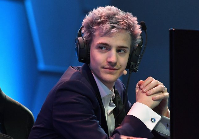 "LAS VEGAS, NV - APRIL 21: Twitch streamer and professional gamer Tyler ""Ninja"" Blevins streams during Ninja Vegas '18 at Esports Arena Las Vegas at Luxor Hotel and Casino on April 21, 2018 in Las Vegas, Nevada. Blevins is playing against more than 230 challengers in front of 700 fans in 10 live ""Fortnite"" games with up to USD 50,000 in cash prizes on the line. He is donating all his winnings to the Alzheimer's Association. (Photo by Ethan Miller/Getty Images)"
