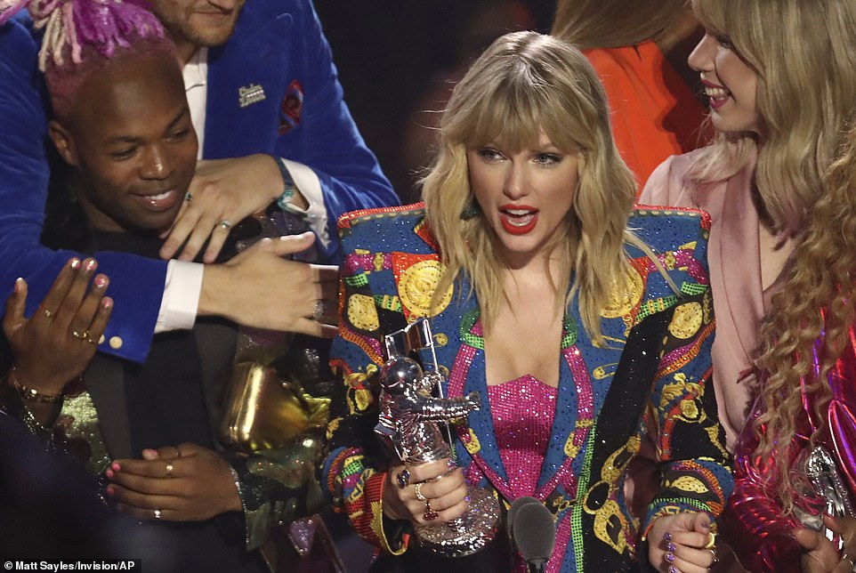 Called out: Taylor Swift who recently said she regrets remaining silent during the 2016 presidential election and vowed to be more active ahead of the 2020 election, made good on her promise during her triumphant night at the ceremonyW