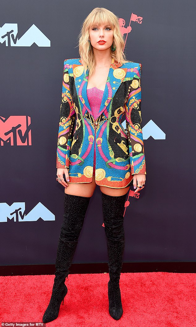 VMA look:Taylor Swift stepped onto the red carpet of the VMA's looking red hot in a Versace blazer and thigh-high sparkly boots