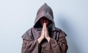 Portrait of Young catholic monk on white background