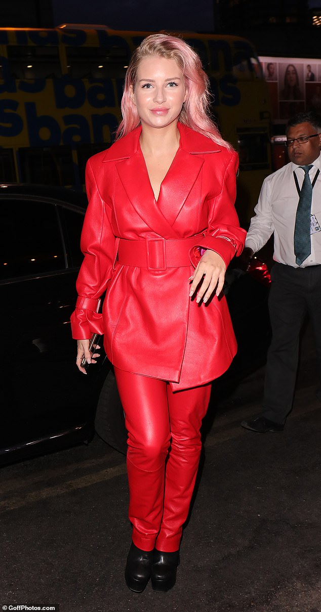 Single and ready to mingle: Hitting dating app Bumble's summer soiree at trendy Shoreditch House, the younger sister of catwalk queen Kate Moss stunned in a red leather suit as she mingled with other famous singletons at the rooftop venue