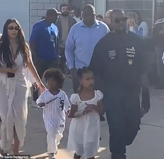 Causing a stir: 'When word got out that Kim, Kanye and the family were at the restaurant tons of people lined up outside to see them,' said a witness; pictured at Sunday Service