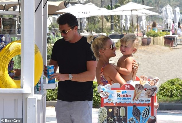 Yummy: During their stroll, the trio headed to an ice cream parlour and tucked into frozen lollies