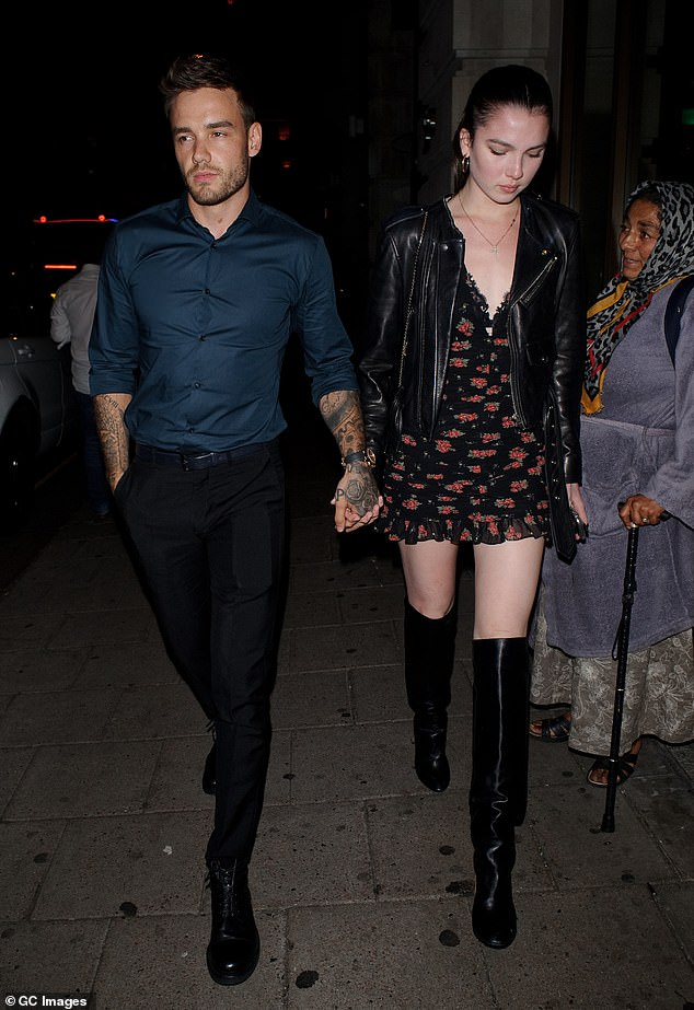 Suave: Liam wore his hair cropped for the evening and completed his look with black trousers and black boots