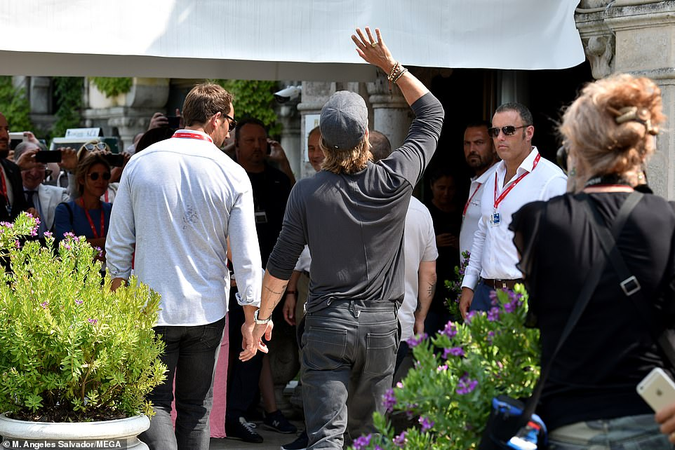 He's still got it! Swarmed by fans, the Curious Case of Benjamin Button star waved at onlookers as he made his way into his hotel