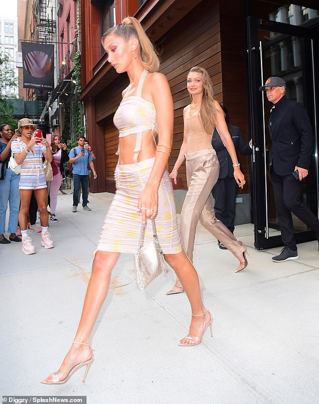 Loved by all: The Hadid's stepped out to the street where dozens of onlookers snapped their pictures
