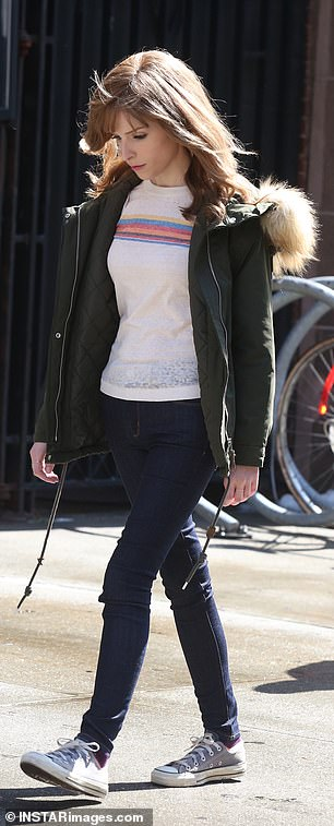 Cute: She was in a cream and striped long sleeved tee, with dark jeans and a pair of Converse sneakers