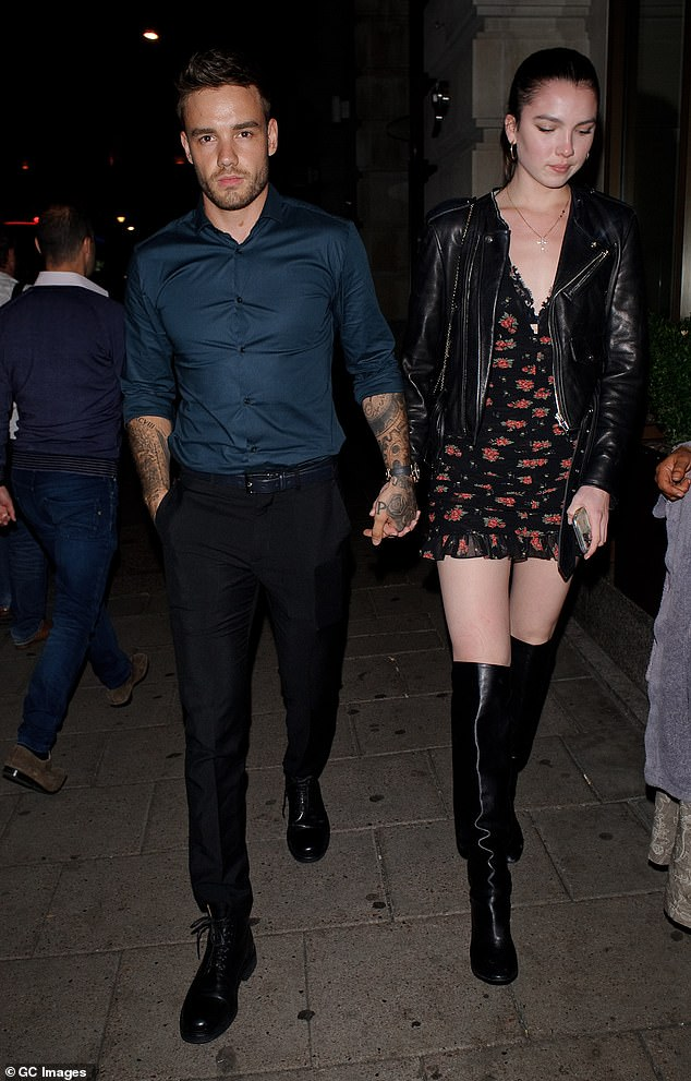 Out and about: Liamwent for a late night stroll with his female companion with the pair looking cosy in each other's company