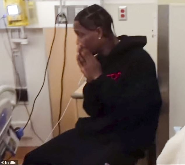 Anxious:The Astroworld singer dressed in his standard black hoodie and track pants while he brought his hands up to a prayer position