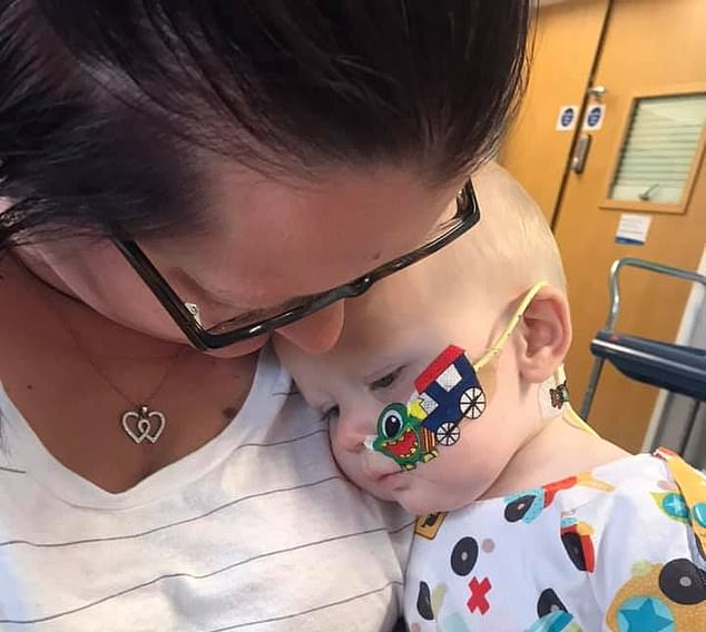 The pair took their son to the doctors straight away, with medics initially believing it was a sign of a hernia - common in babies (pictured with Ms Burgess)