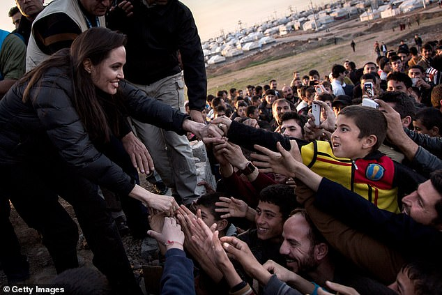 World traveler: The mother of six worked for more than a decade as a UNHCR Goodwill Ambassador before being promotedto Special Envoy to High Commissioner Antonio Guterres; she's pictured meeting people of the Yazidi minority in Khanke, Iraq in January 2015