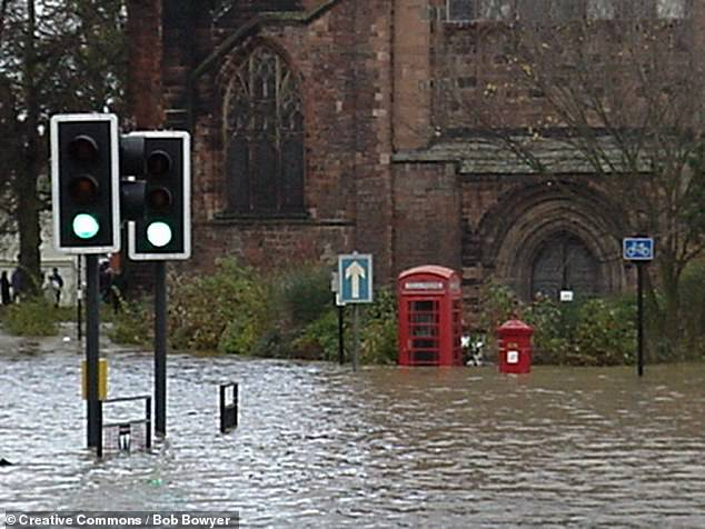 Floods outside Shrewsbury Abbey, in Shropshire, England, in 2000. Here, the waters are pictured at their highest level