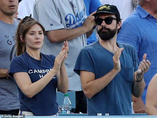 Clapping for the home team: Rounding out the famous faces were Marvel actress Elizabeth Olsen and her musician fiance Robbie Arnett
