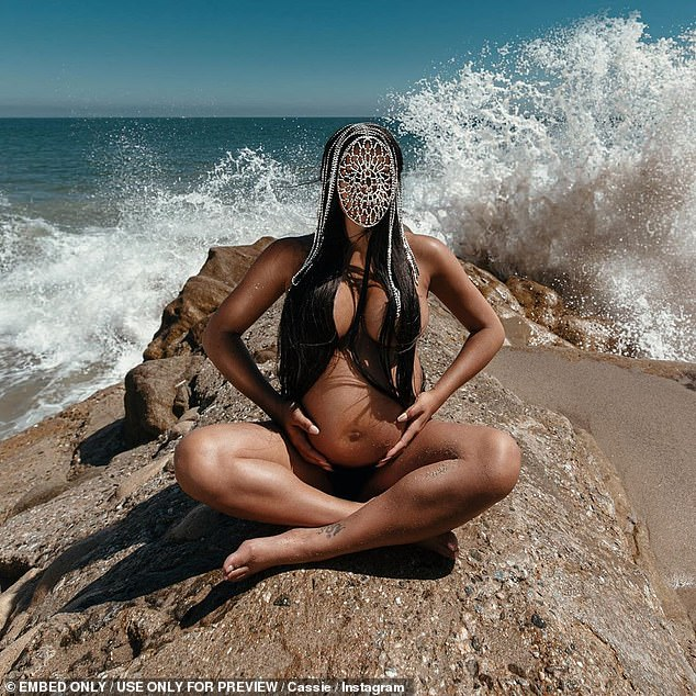 She's glowing: In honor of her 33rd birthday, she stripped down to her birthday suit to lounge around some rocks in an ocean-side shoot