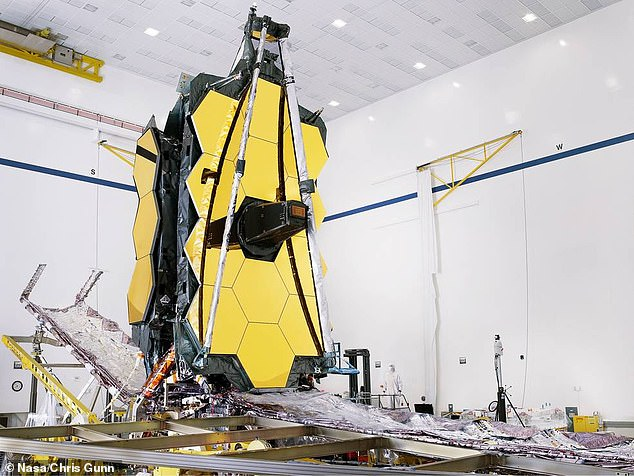 JWST(pictured)  is a joint venture between NASA, ESA and Canadian agency CSA. The giant jigsaw puzzle of assembly saw engineers lift the Webb telescope ¿ complete with mirrors and delicate instruments ¿ above the sunshield and spacecraft.