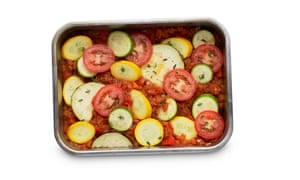 Felicity Cloake Ratatouille 05: 8 Pour the sauce into an oven dish, arrange the courgettes and aubergine on top, season and bake